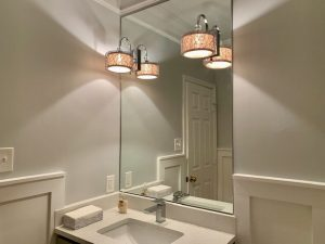 new sink and hovering light fixtures as part of a bathroom remodel in maryland