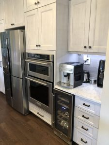 amazing kitchen makeover with in wall oven installation and beautiful new white countertops in maryland