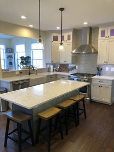 kitchen remodel near me with new island, chairs, and stove