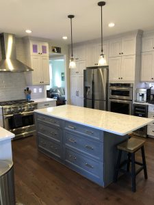 kitchen make over with a dark wood island and white grey countertop