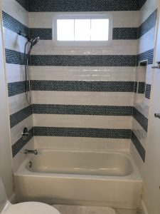 black and white striped tile tub install for bathroom makeover in maryland