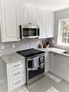 a new microwave, stove top, and countertops for a kitchen remodel