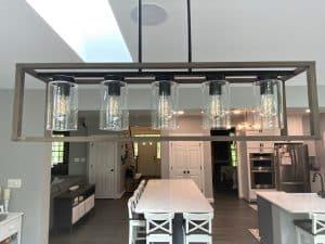 a new light fixture enhances a maryland kitchen